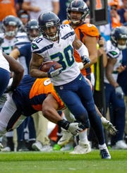 Seahawks safety Bradley McDougald runs after one of his two interceptions against the Denver Broncos on Sept. 9.