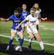 Mia St. Peter of North Kitsap and Jayda Day of Olympic battle for control of the ball at Silverdale Stadium on Sept. 25.