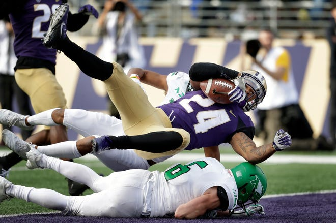 Washington sophomore running back Kamari Pleasant scores a touchdown against North Dakota on Sept. 8 in Seattle.