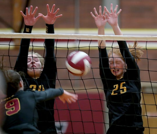 Andea Harteloo, left, and Faith Smith of South Kitsap block Kingston's Grace Hentzel during a Sept. 5 game at South Kitsap.