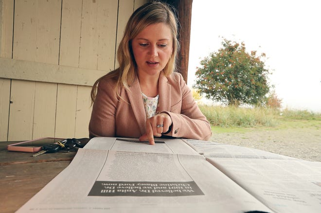 Ashley Horvat looks over the ad that she put in USA TODAY supporting Dr. Christine Blasey Ford - the first woman to claim she was assaulted by Supreme Court nominee Brett Kavanaugh - on Wednesday, September 26, 2018 at Fay Bainbridge Park.