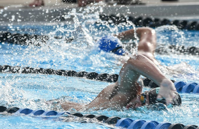 Joey Otero of Bayside swims the 100 freestyle during Tuesday's meet against Bayside at Palm Bay Aquatic Center