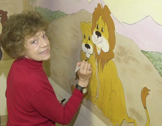 Barb Dolch works on a Noah's Ark mural in the nursery of the First Presbyterian Church on Poplar Street in 2006.  The park district renamed the Colonel Crawford Bikeway the Barb Dolch Memorial Bikeway in her honor.
