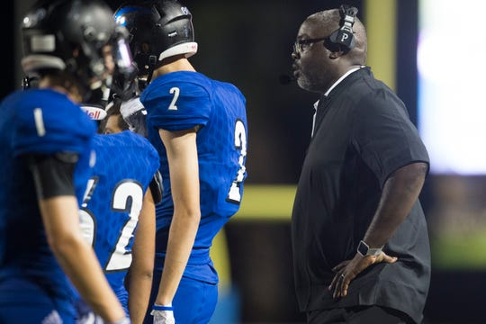 Santa Gertrudis Academy head coach Ivory Dillard coaches during their game against Odem on Thursday, Sep. 20, 2018, at Javelina Stadium in Kingsville.