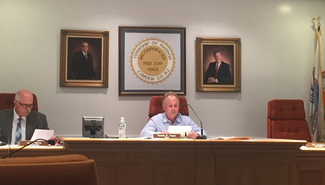 Haddon Township Commissioner James Mulroy, left, and Mayor Randall Teague sit next to Commissioner Paul Dougherty's empty chair at Tuesday night's meeting.