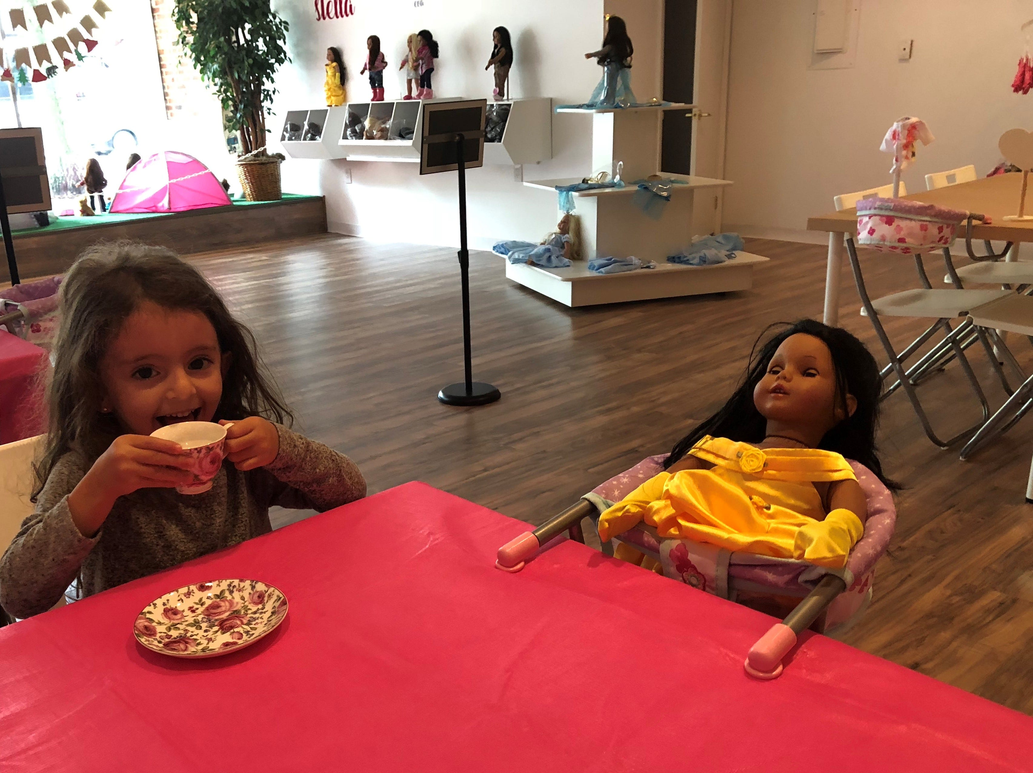 Stella Fiorentino, 4, enjoys tea time with her doll, Belle, at Stella & Toni in Haddonfield.