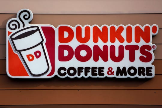 This file photo shows the Dunkin' Donuts logo on a shop in Mount Lebanon, Pa. Dunkin' is dropping the donuts -- from its name, anyway. Doughnuts are still on the menu, but the company is renaming itself 'Dunkin' ' to reflect its increasing emphasis on coffee and other drinks. The change will officially take place in January 2019.