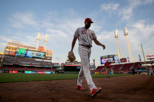 Cincinnati Reds starting pitcher Cody Reed (25) walks back to the dugout after second  inning during a baseball game between the Kansas City Royals and the Cincinnati Reds, Wednesday, Sept. 26, 2018, at Great American Ball Park in Cincinnati.