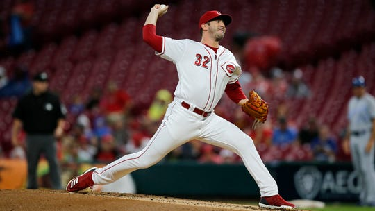 Cincinnati Reds starting pitcher Matt Harvey (32) delivers a pitch in the second inning of the MLB Interleague game between the Cincinnati Reds and the Kansas City Royals at Great American Ball Park in downtown Cincinnati on Tuesday, Sept. 25, 2018.