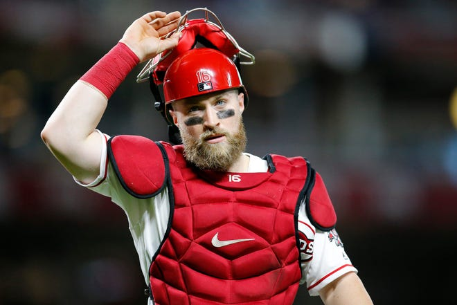 Cincinnati Reds catcher Tucker Barnhart (16) returns to the dugout after the top of the sixth inning of the MLB Interleague game between the Cincinnati Reds and the Kansas City Royals at Great American Ball Park in downtown Cincinnati on Tuesday, Sept. 25, 2018.