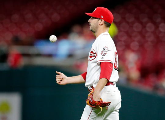 Cincinnati Reds starting pitcher Matt Harvey (32) tosses a ball to himself after giving up a home run to Kansas City Royals first baseman Ryan O'Hearn (66) in the fourth inning of the MLB Interleague game between the Cincinnati Reds and the Kansas City Royals at Great American Ball Park in downtown Cincinnati on Tuesday, Sept. 25, 2018.