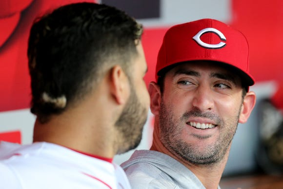 Cincinnati Reds starting pitcher Matt Harvey (32) talks with Cincinnati Reds third baseman Eugenio Suarez (7) in the dugout in the first inning during a baseball game between the Kansas City Royals and the Cincinnati Reds, Wednesday, Sept. 26, 2018, at Great American Ball Park in Cincinnati.