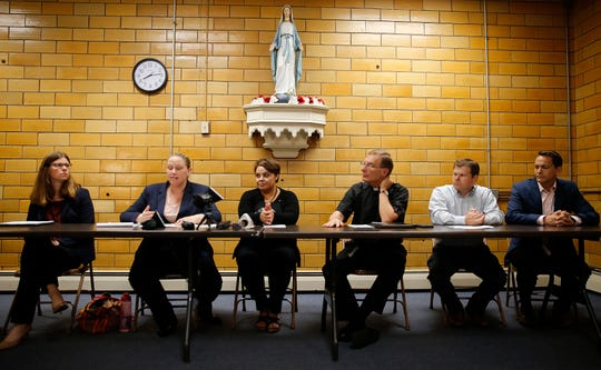 Attorneys Emily Brown, left, and Kathleen Kersh with their client  Maribel Trujillo-Diaz, center, The Rev. Mike Pucke, Tony Stieritz and The Rev. Alan Dicken speak with the media after a Welcome Home prayer service for Truijilo-Diaz,  at St. Julie Billiart Parish, in Hamilton, Tuesday, September 25, 2018.  Truijilo-Diaz, an asylum seeker, has been reunited with her family following 17 months of separation. She received an outcry from various religious, human rights organizations and public officials when she was deported to Mexico City, leaving her husband and four U.S. born children behind.