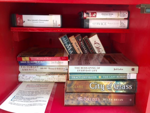 Books and audio books at the Little Free Library at Promont.