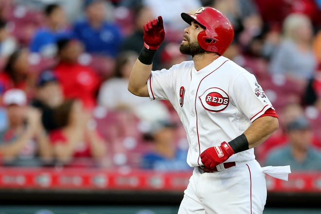 Cincinnati Reds second baseman Jose Peraza (9) celebrates a solo home run in the first inning during a baseball game between the Kansas City Royals and the Cincinnati Reds, Wednesday, Sept. 26, 2018, at Great American Ball Park in Cincinnati.