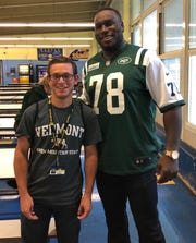 New York Jet Jonotthan Harrison and Colonia junior Jason Mahan met at Colonia High School on Tuesday.