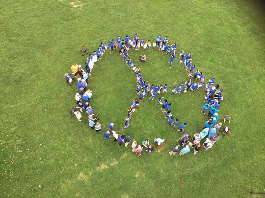 Giant human peace sign.
