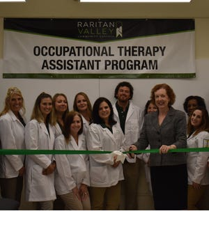 Dr. Deborah E. Preston, Raritan Valley Community College Provost and Vice President of Academic Affairs, joins occupational therapy assistant students at the Sept. 12 ribbon-cutting ceremony of the College's new occupational therapy assistant laboratory.