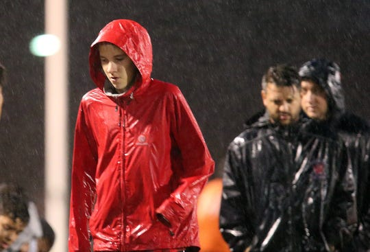 Ben Lepisto and his Woodbridge High School soccer teammates weathered rainy conditions during Tuesday night's home game against Edison.