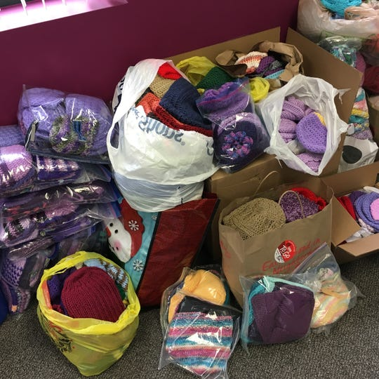 I am waiting until Friday to count all these hats, but as you can see, there are quite a lot, and more come in every day. Thank you!