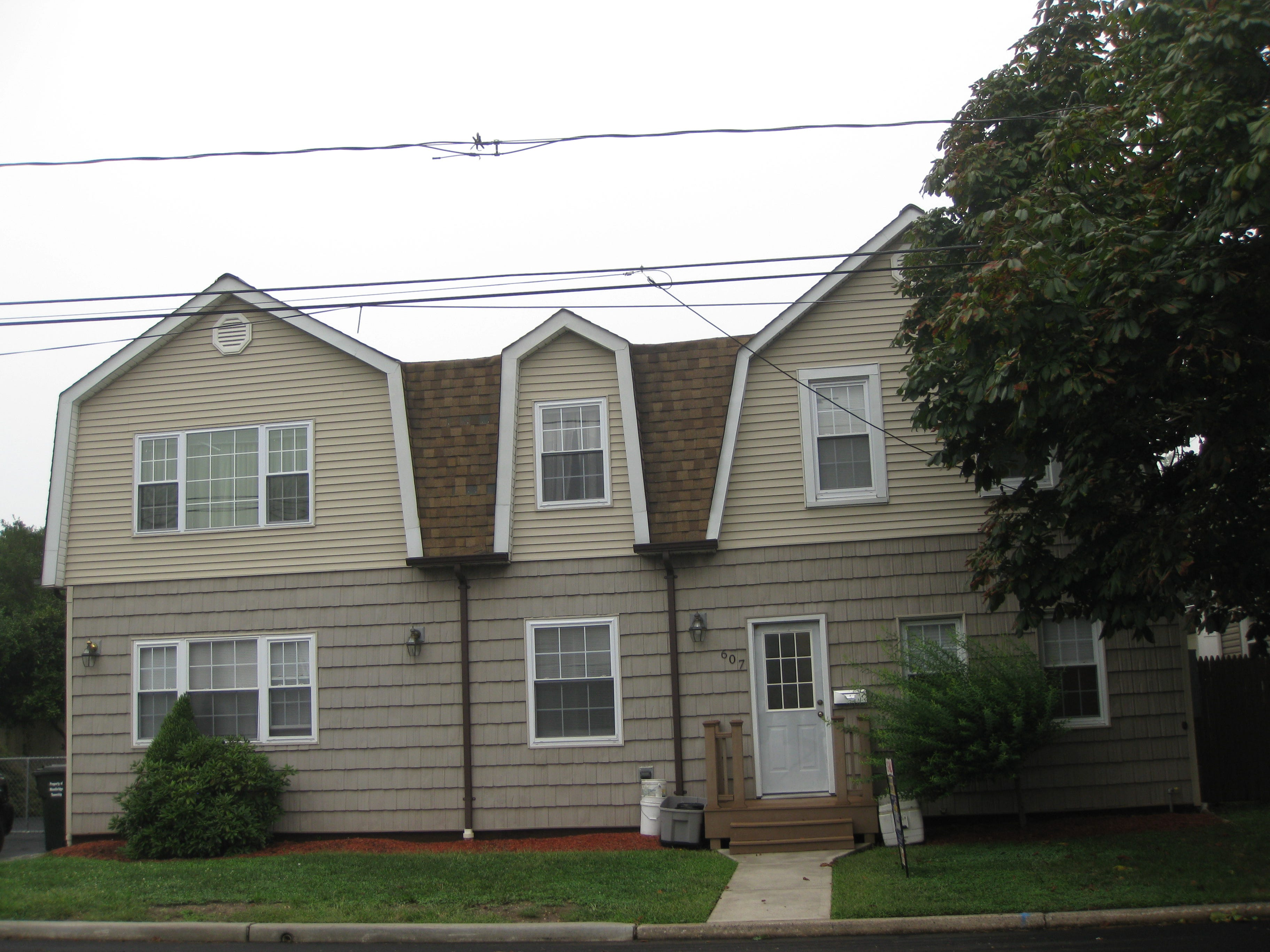 This two-family home in the heart of Woodbridge has a convenient location, two two-bedroom apartments with eat-in kitchens, a fenced backyard with a swimming pool and a full basement. It's offered at $494,900.