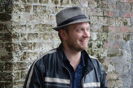 Charlie Bondhus, author of a new book of poetry, Divining Bones (Sundress Publications).