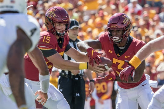Iowa State freshman quarterback Brock Purdy (15) hands the ball off the Kene Nwangwu (3) during the Cyclones' game vs. Akron.