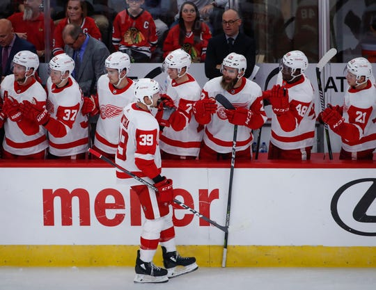 Detroit Red Wings right wing Anthony Mantha (39) celebrates with teammates after scoring against the Chicago Blackhawks during the second period of an NHL hockey preseason game Tuesday, Sept. 25, 2018, in Chicago.