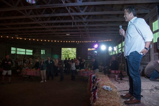 Congressman Mike Bishop address the crowd during a private fundraiser event for his re-election campaign in Hartland, Friday, September 21, 2018.
