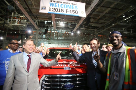 UAW's  Jimmy Settles, left, Executive Chairman of Ford, Bill Ford, center, CEO Mark Fields and a plant worker Kenneth Payne II are all on hand to celebrate the launch of the new 2015 F-150 at the Dearborn Truck Plant at the Ford Rouge Center in November 2014.
