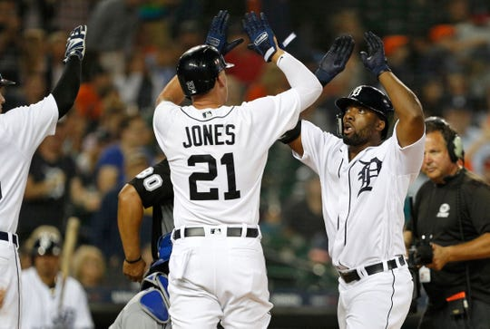 Detroit Tigers Christin Stewart (14) celebrates with JaCoby Jones (21) after hitting a three run homer against the Kansas City Royals at Comerica Park on Sept. 20, 2018.