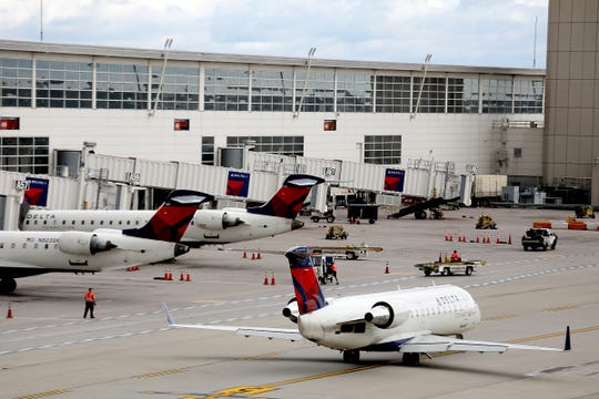 Delta Air Lines planes at the McNamara terminal at the Detroit Metropolitan Airport in Romulus on Wednesday, Sept. 26, 2018. Detroit is Delta's second largest hub.
