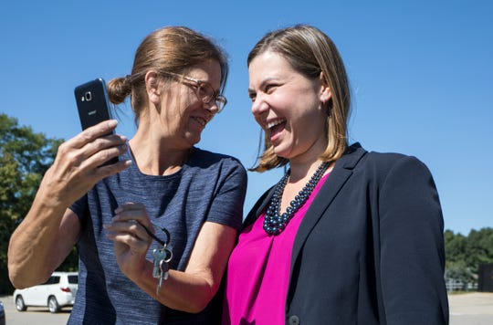 Renee Snyder, 55, left, a volunteer from Green Oak Township, jokes with Michigan 8th Congressional District Democratic nominee Elissa Slotkin at Spencer Elementary School in Brighton, Sunday, September 23, 2018.