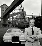Lee Iacocca, as a young man, already president of Ford Motor Company, pictured here in front of the River Rouge Plant in 1971.