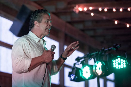 Congressman Mike Bishop address the crowd during a private fundraiser event for his reelection campaign in Hartland, Friday, September 21, 2018.