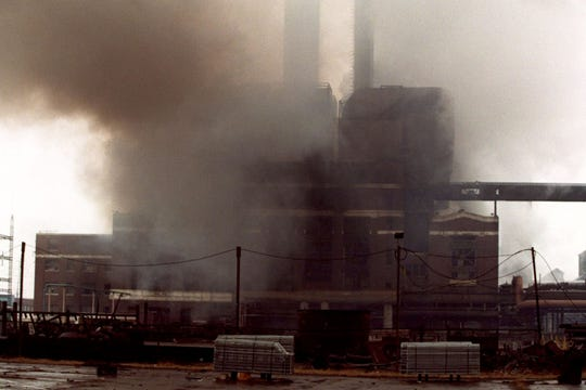 Smoke spews after an explosion at the Powerhouse building on the grounds of the Ford River Rouge plant, Monday,  February 1, 1999.
