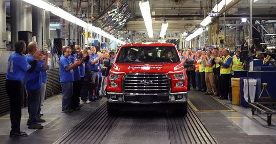 The first 2015 Ford F-150 truck comes off the assembly line at the Dearborn Truck Plant at the Ford Rouge Center on November 11, 2014 in Dearborn.