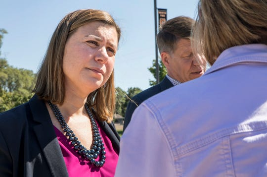 Michigan 8th Congressional District Democratic nominee Elissa Slotkin speaks with volunteers at Spencer Elementary School in Brighton, Sunday, September 23, 2018.