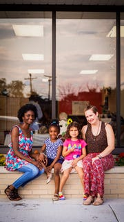 Detroit Mama Hub co-founder Jalyn Spencer-Harris (far left) with her 5-year-old daughter Violet, and her co-founder Alex Fluegel (far right) with her 5-year-old daughter Sadira.