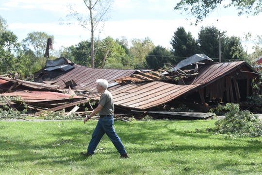 Dennis Pogarch walks pass the remains of the family barn at Steiner Road in Frenchtown Township on Wednesday, September 26, 2018.