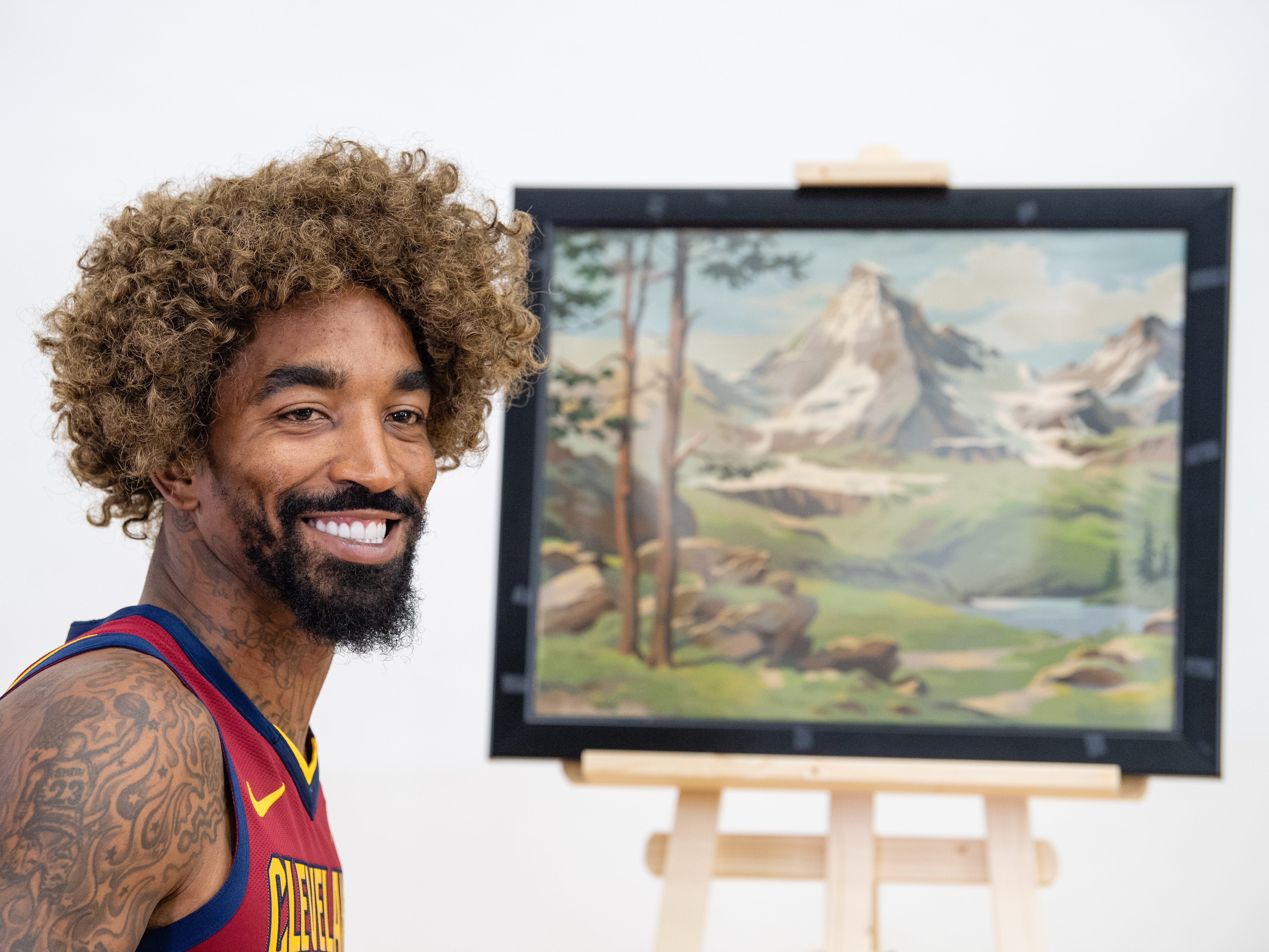 J.R. Smith of the Cleveland Cavaliers poses as painter Bob Ross for Cavs social media on Media Day at Cleveland Clinic Courts on September 24, 2018 in Independence, Ohio.