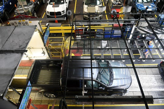 A Ford F-150 rolls along the line at the Ford Dearborn Truck Plant Final Assembly in the Rouge Complex in Dearborn, Mich. on Sept. 25, 2018.