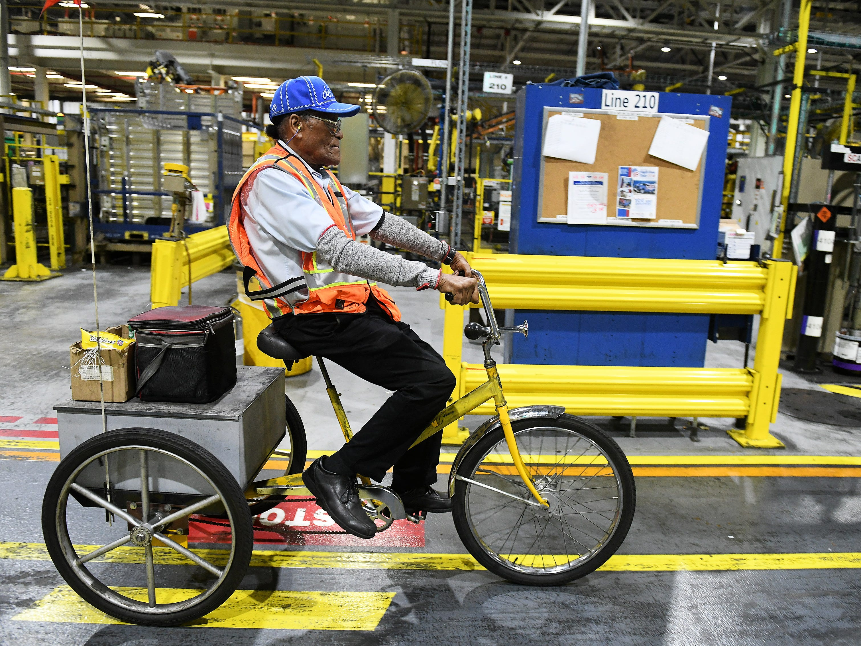 Willie Fulton, 86, rides a tricycle back and forth between the two lines he monitors at Ford Dearborn Stamping in the Rouge Complex .
