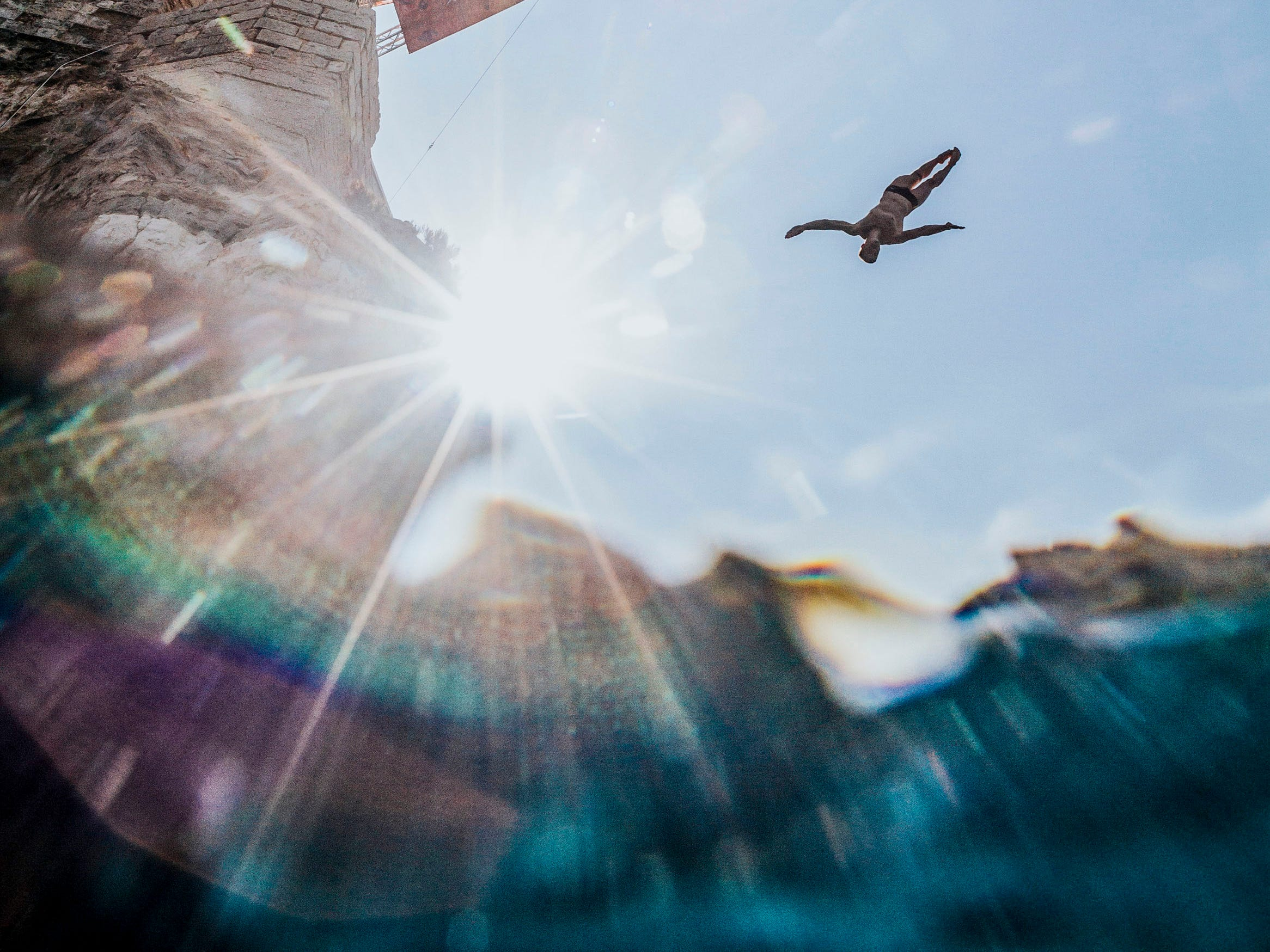 In this image provided by Red Bull, Andy Jones of the U.S. dives from the 27-meter platform during the last competition day of the seventh and final stop of the Red Bull Cliff Diving World Series on Sept. 23, 2018 at Polignano a Mare, Italy.