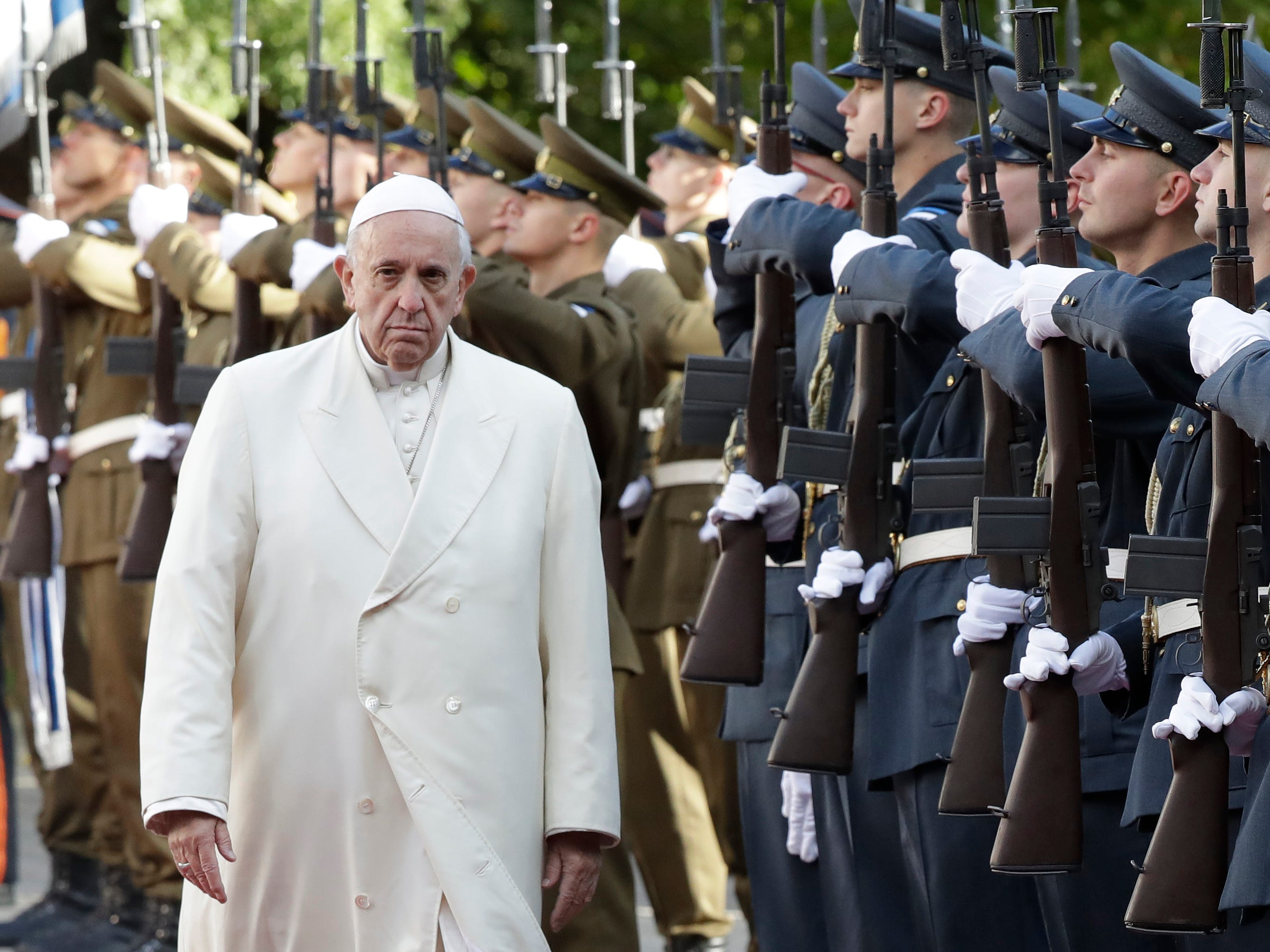 Pope Francis reviews the honor guard during the welcome ceremony at the Kadriorg Presidential Palace, Estonia, Tuesday, Sept. 25, 2018. Pope Francis' visit concludes his four-day tour of the Baltics.