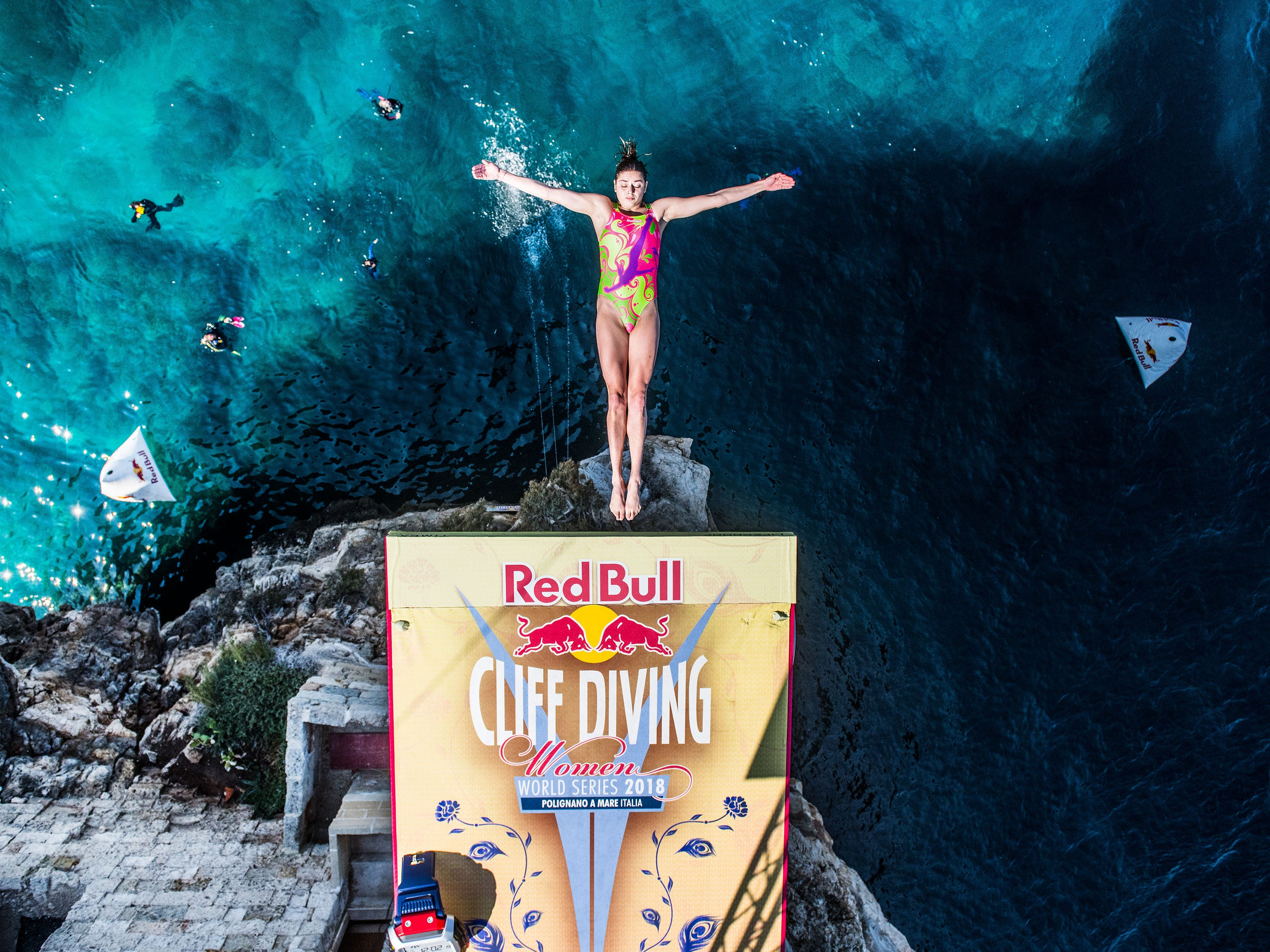 Yana Nestsiarava of Belarus dives from the 21-meter platform during the first competition day of the seventh and final stop of the Red Bull Cliff Diving World Series on Sept. 22, 2018 at Polignano a Mare, Italy.
