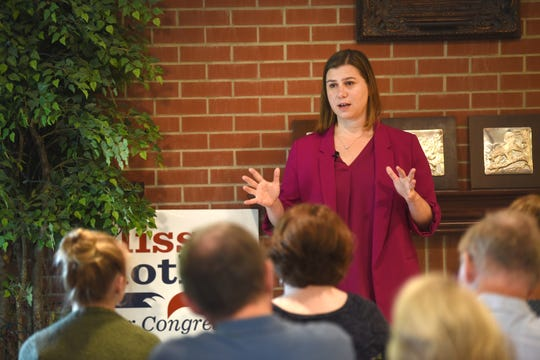 Democrat Elissa Slotkin of Holly addresses a crowd at a house party in Lake Orion on Saturday, September 15, 2018.