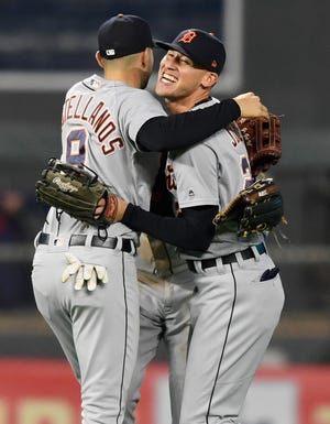 Nick Castellanos and JaCoby Jones of the Detroit Tigers celebrate defeating the Minnesota Twins.