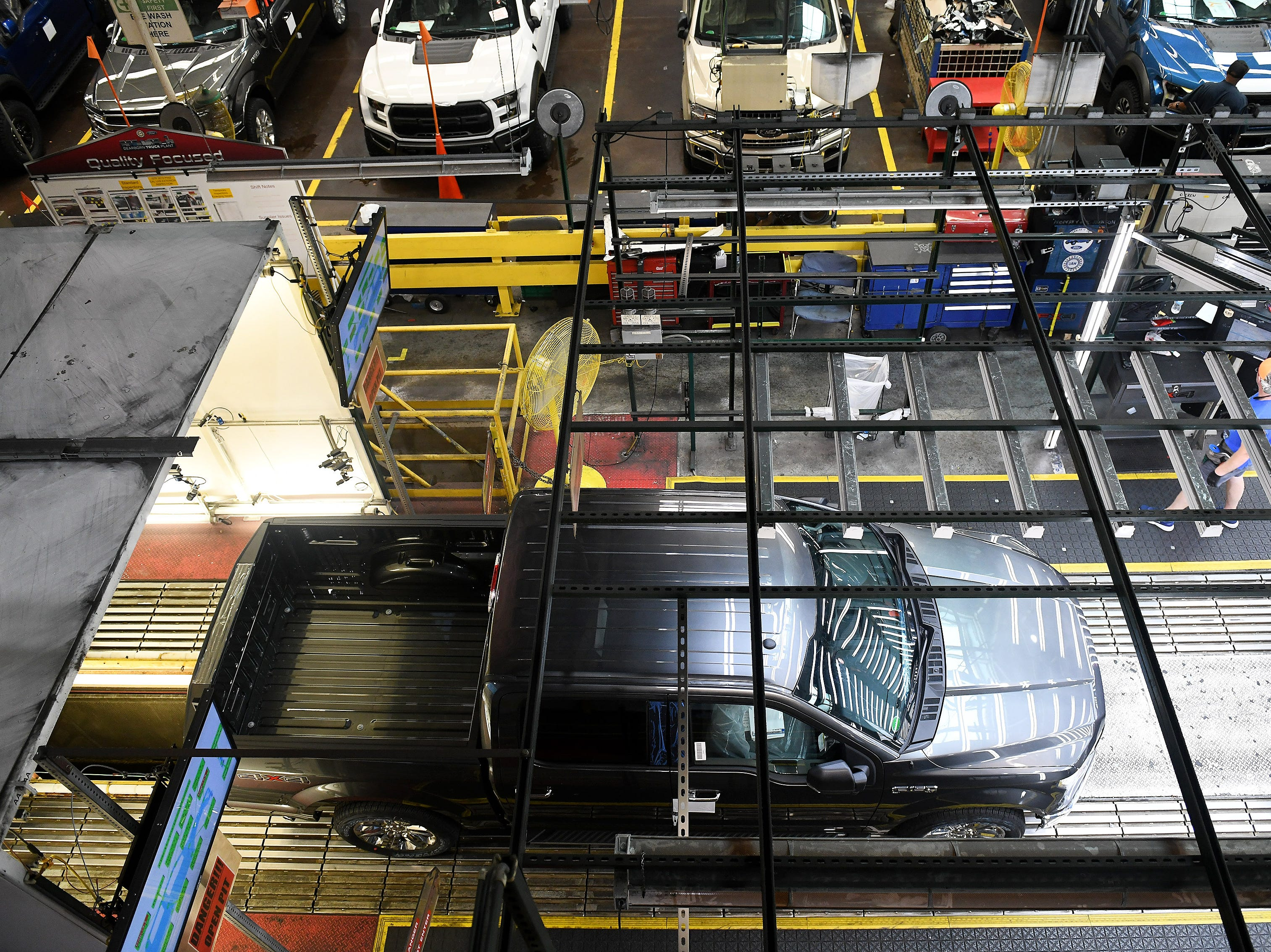 A Ford F-150 rolls along the line at the Ford Dearborn Truck Plant Final Assembly in the Rouge complex on Sept. 25, 2018.
