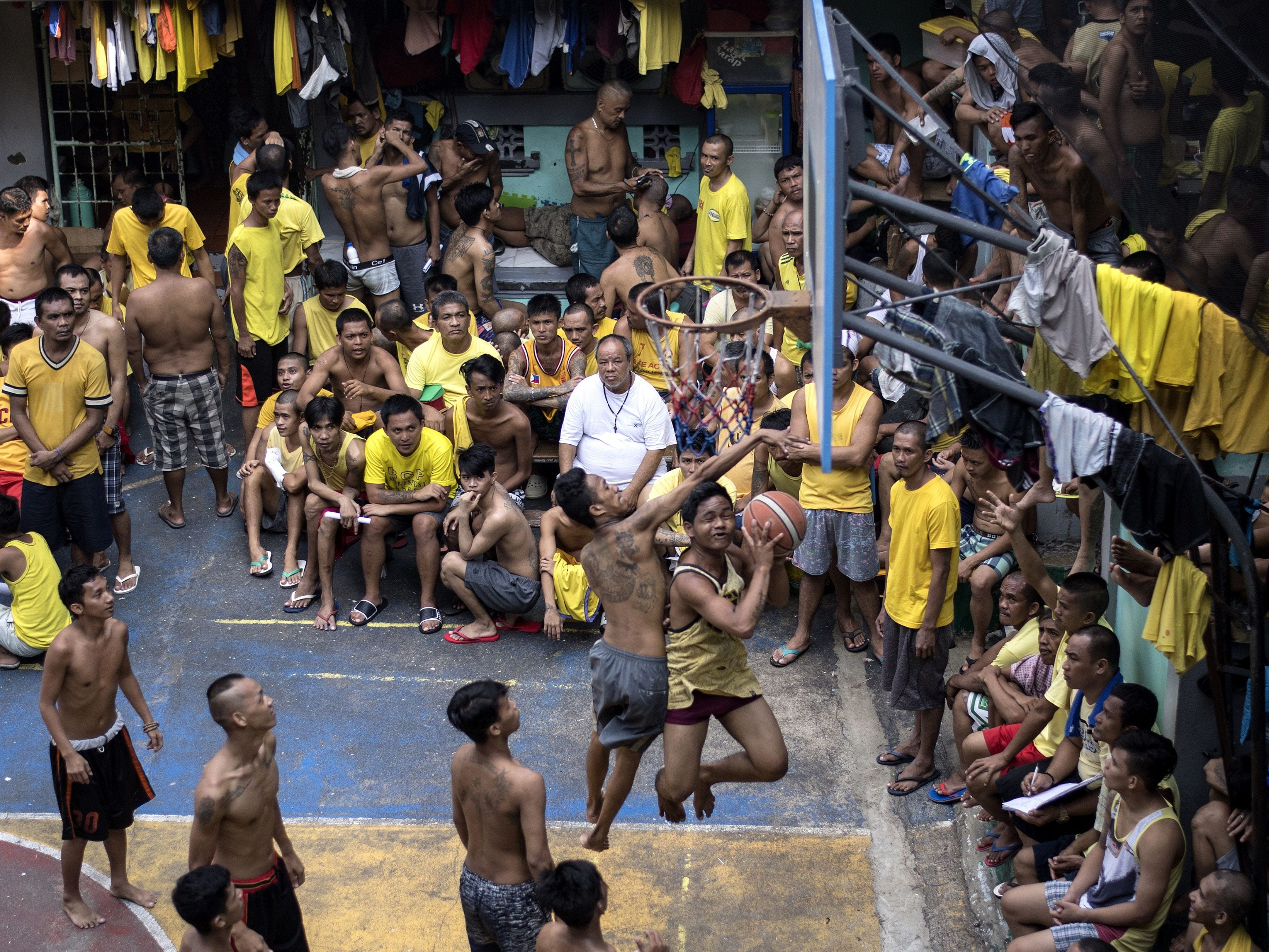 Inmates play basketball in the Quezon City jail in suburban Manila on Tuesday, Sept. 25, 2018.